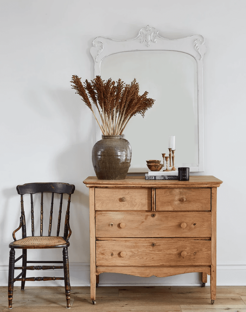 chair and sideboard in entryway.