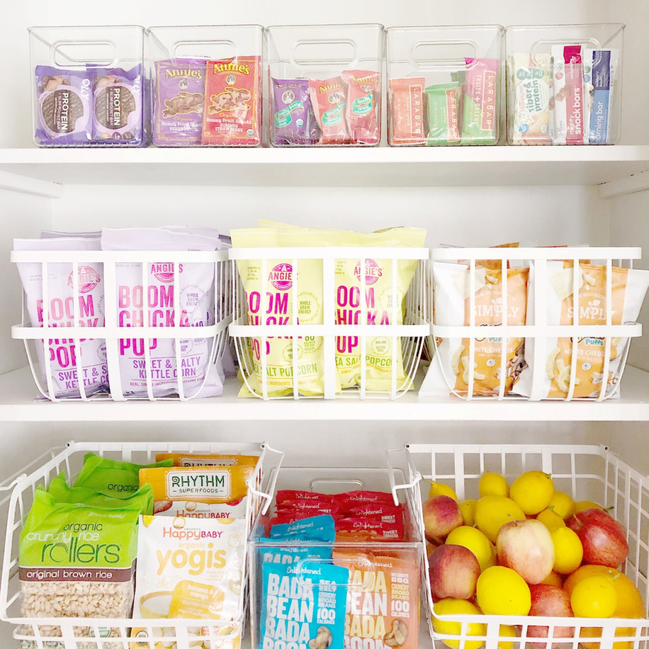 Pantry with white wire baskets and snacks.