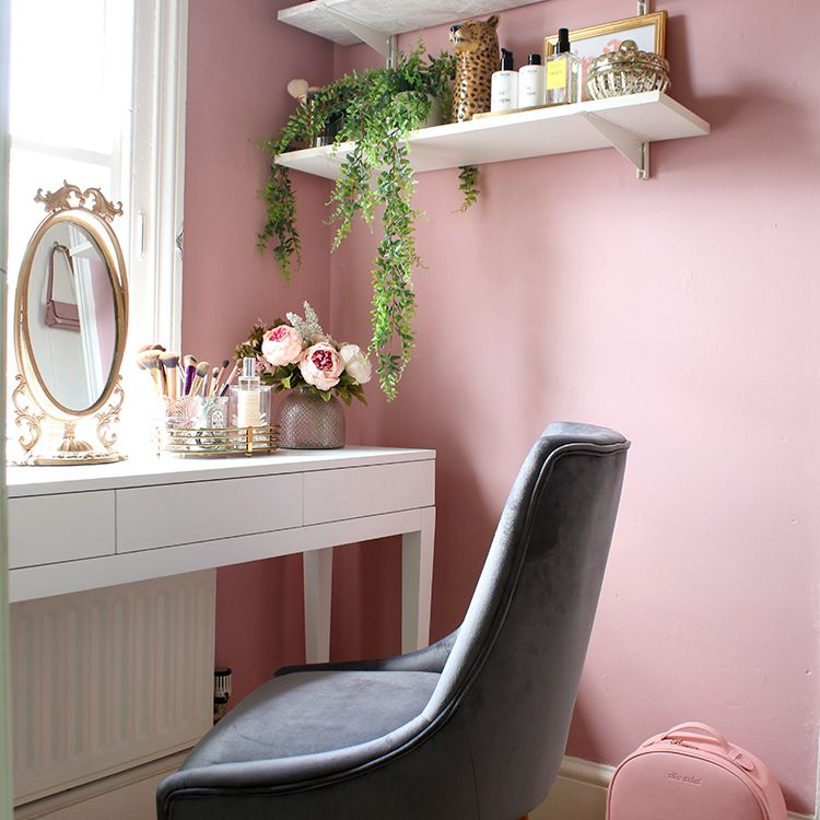 Chic vanity setup with shelves hanging overhead.