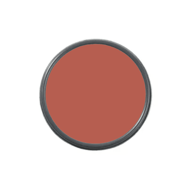 An overhead shot of a paint can with red paint in it