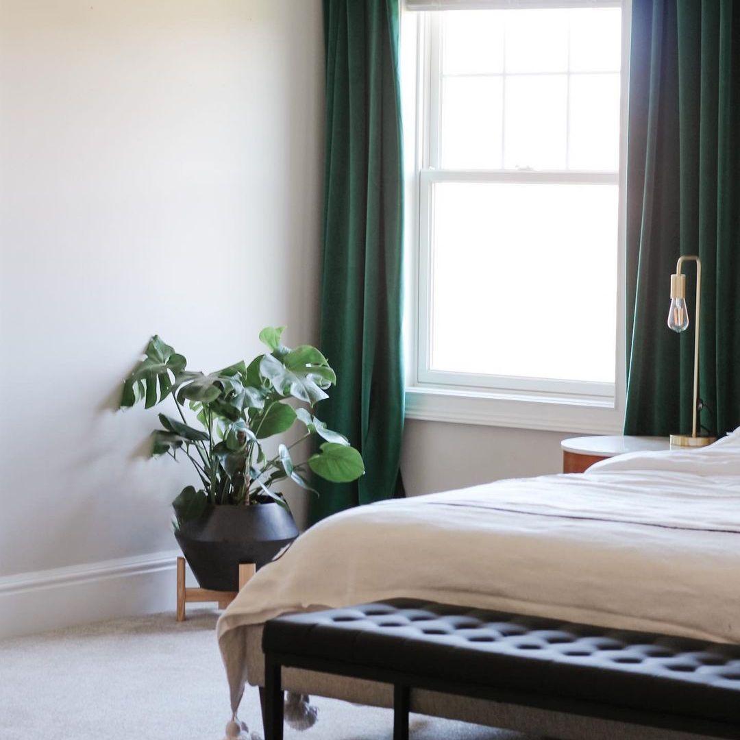Green drapes in bedroom