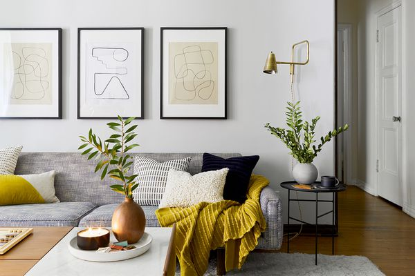 living room with gray sofa and yellow accents