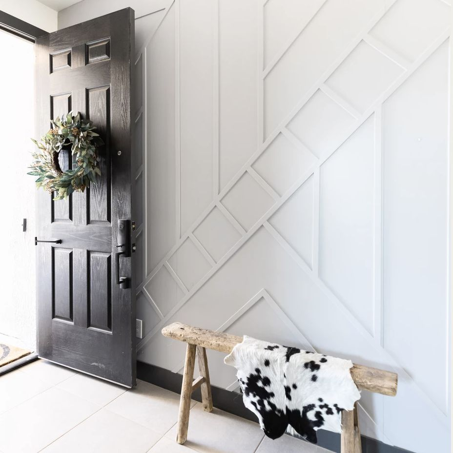 entryway with white walls and raised texture