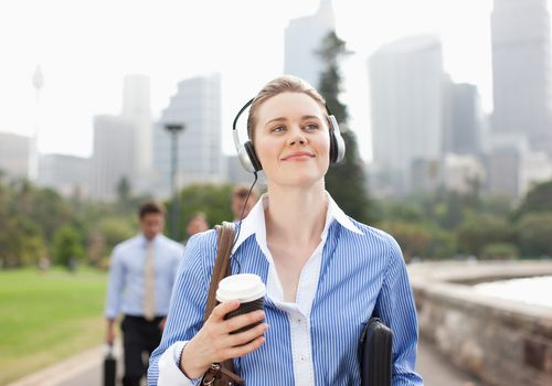 woman walking with headphones on