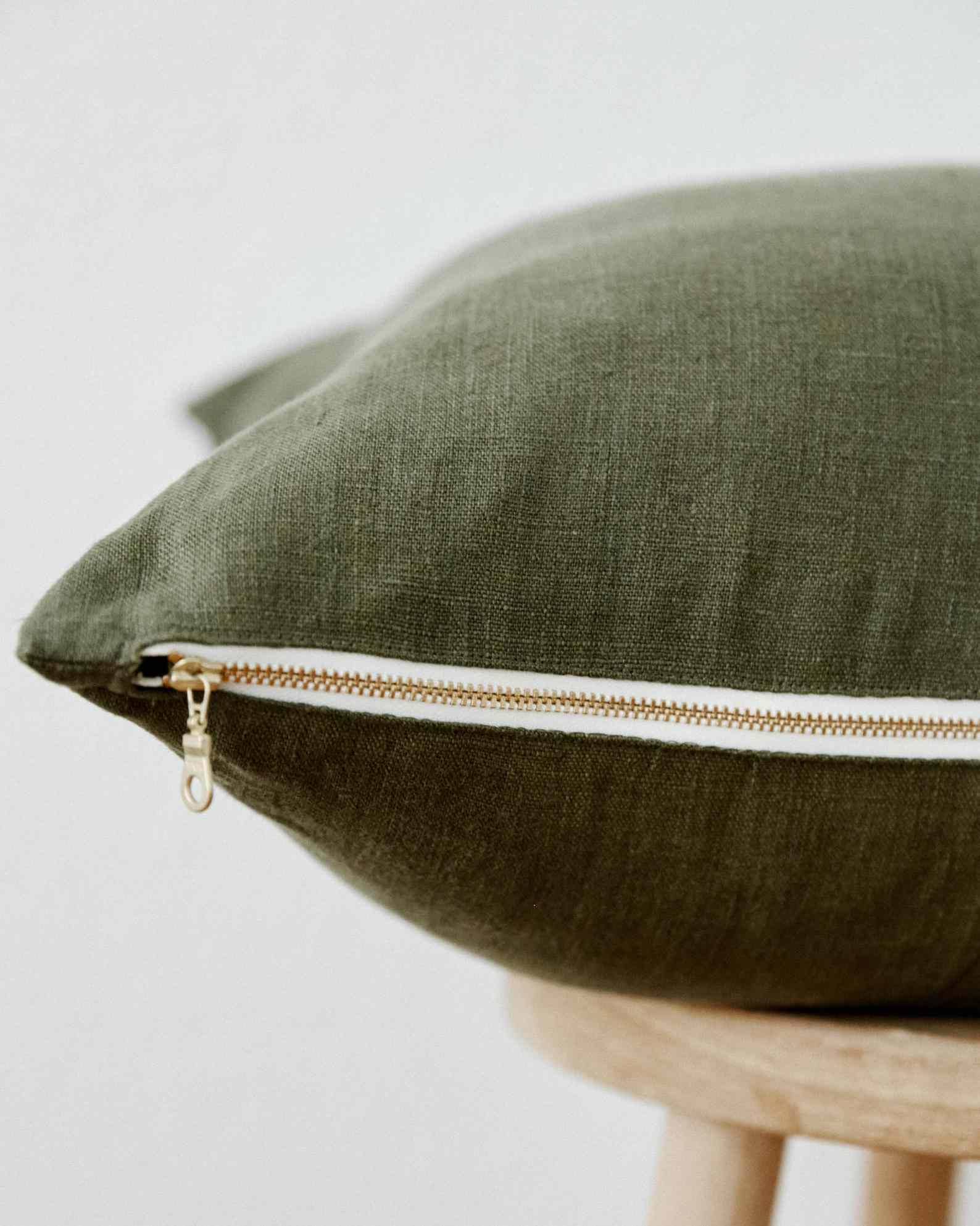 Linen pillow cover in olive