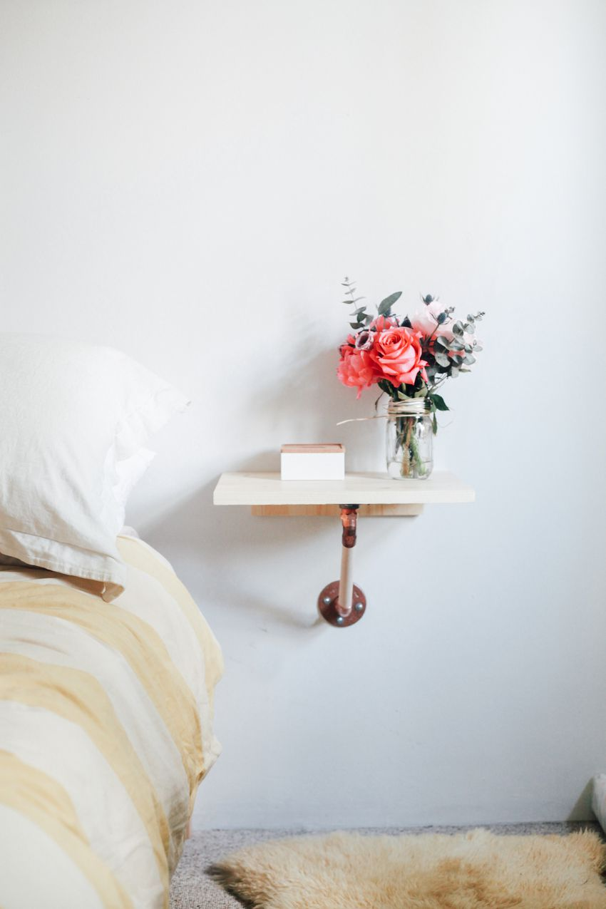 Flowers on a bedside table.