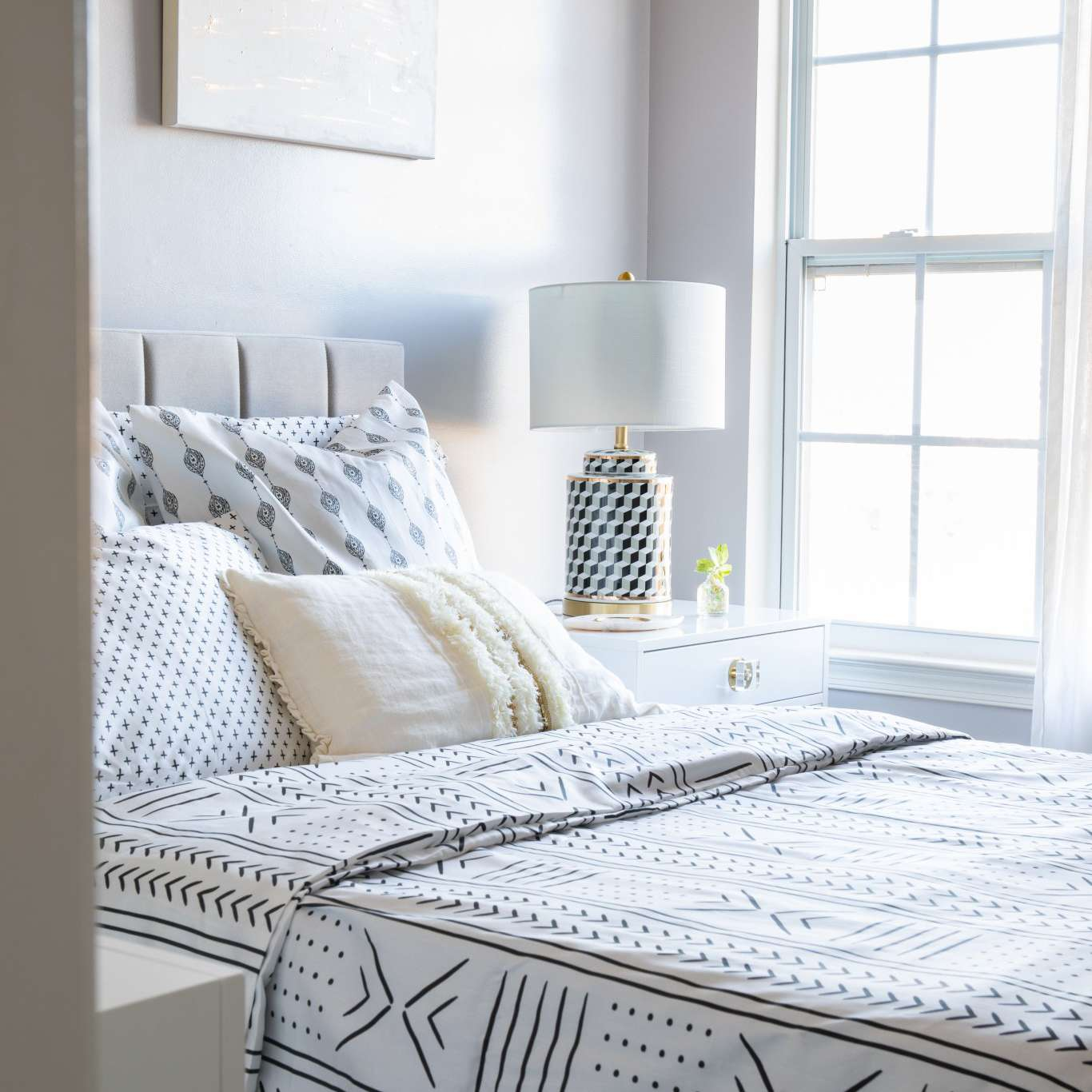 White bedroom with patterned sheets