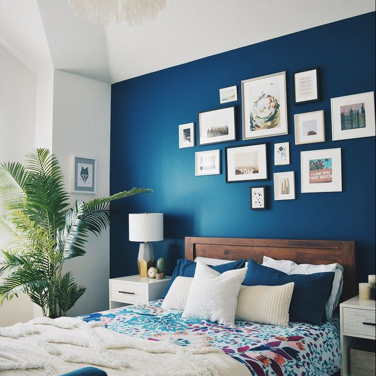 Navy bedroom with artsy flair