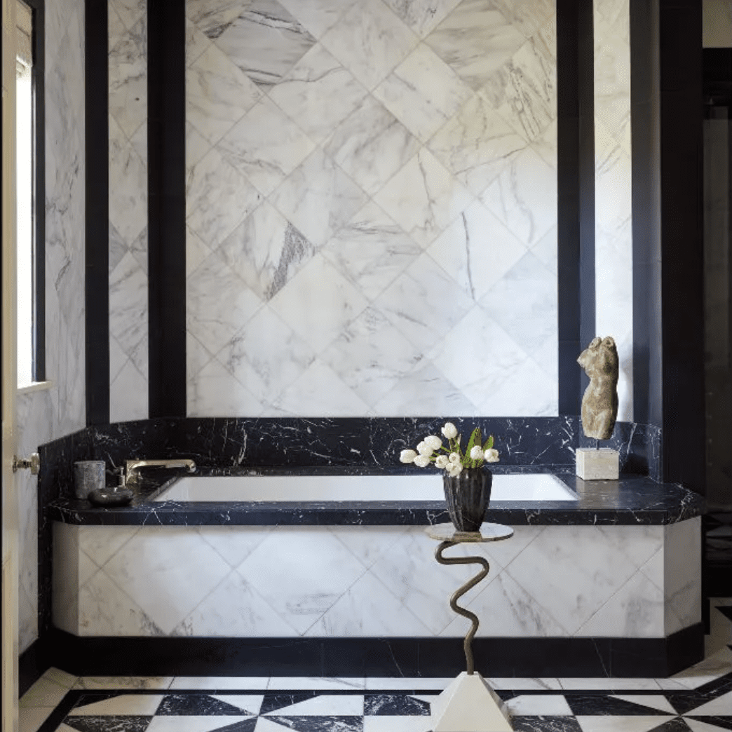 Black-and-white-tiled bathroom with decorative sculptures