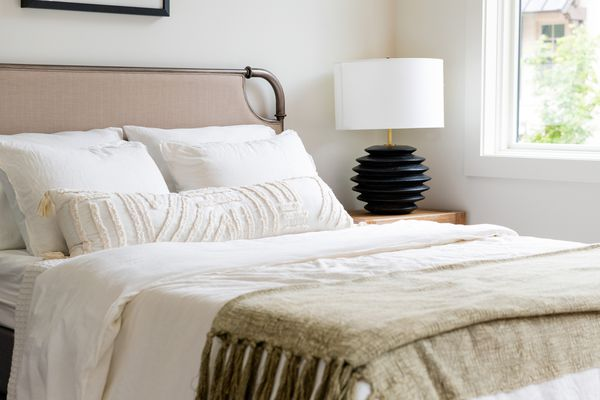 Stylish Bed And Bedside Table In Modern Home by Ali Harper