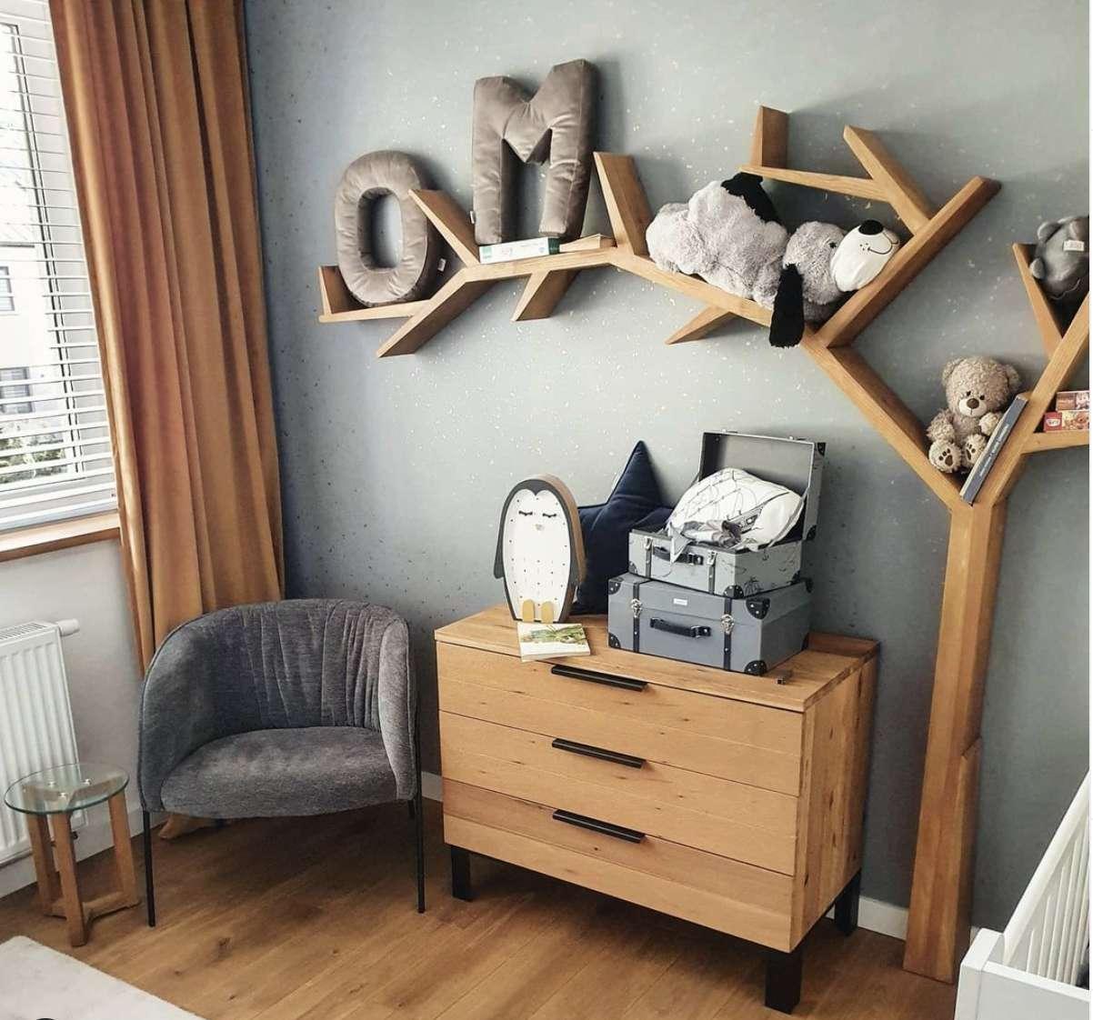 nursery with DIY tree branch shelf