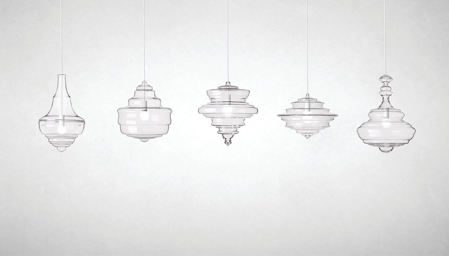 A series of similar-looking pendant lights, currently for sale at Design Within Reach