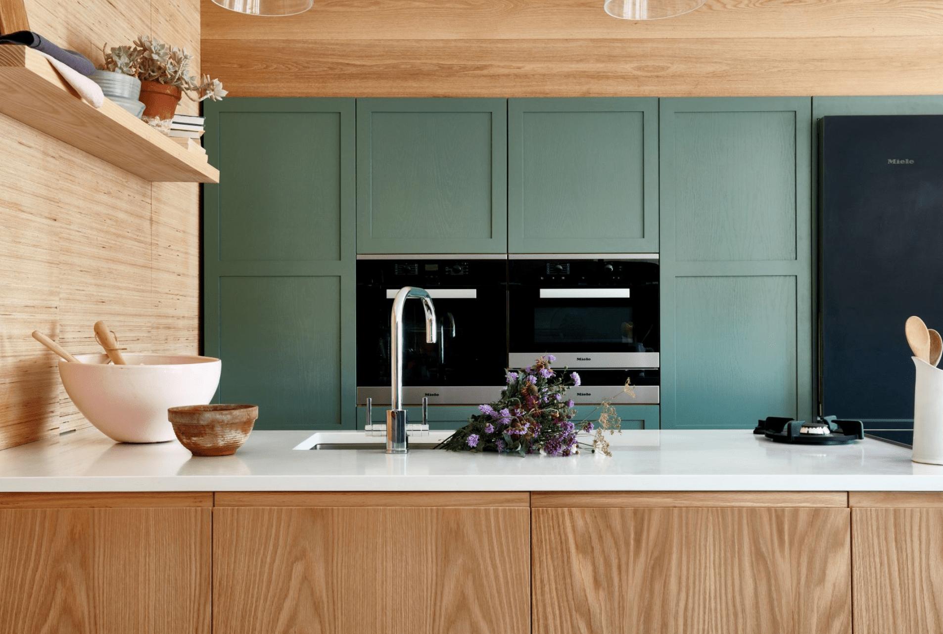 Green kitchen with quartz countertops
