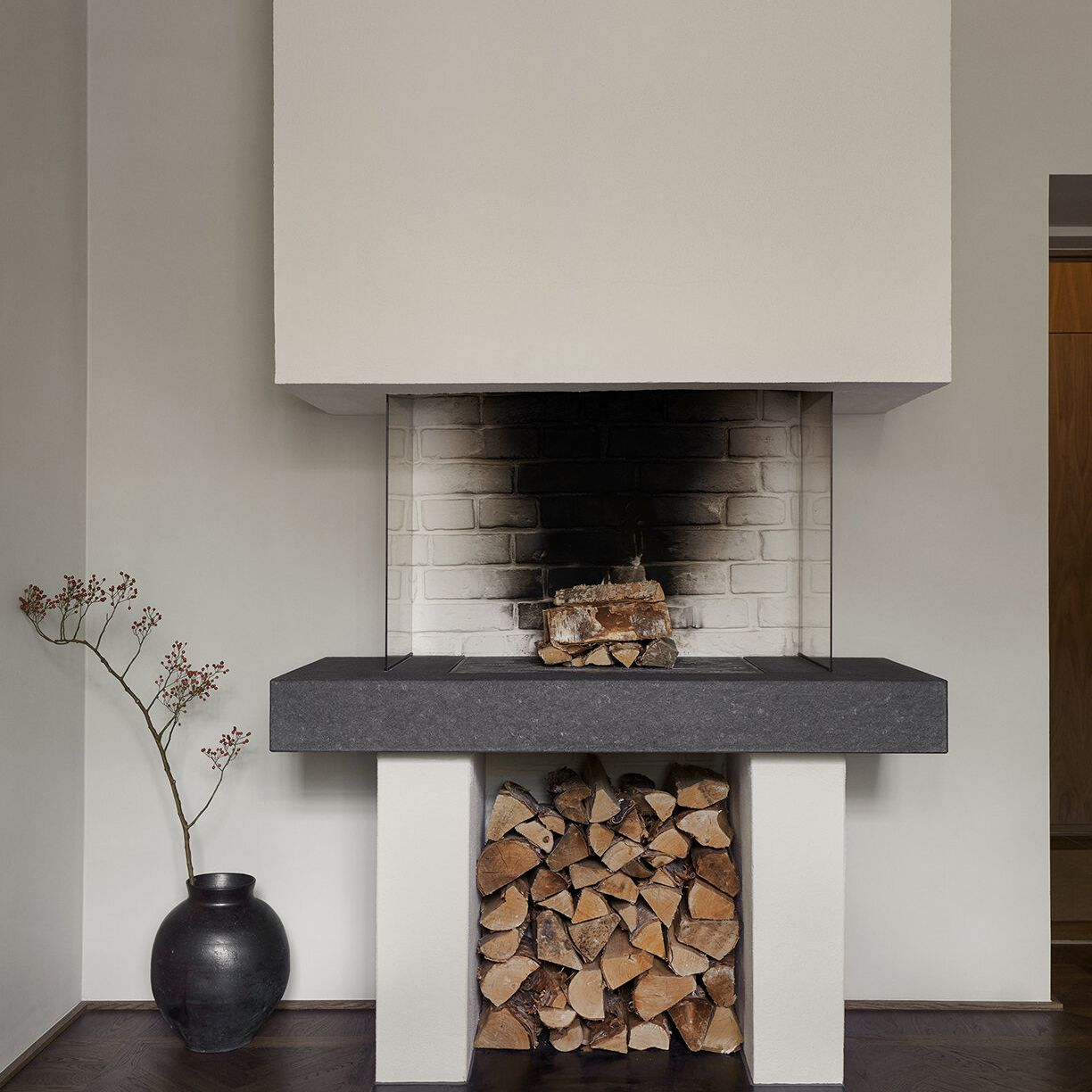 An industrial fireplace with a smoke stain