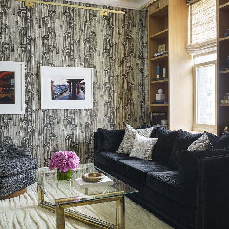 Wallpapered living room with a dark sofa