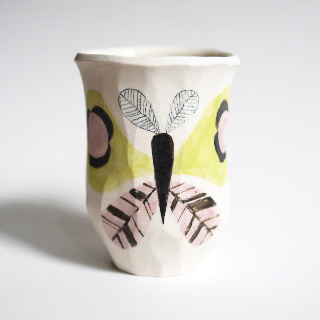 Painted butterfly tumbler on neutral background