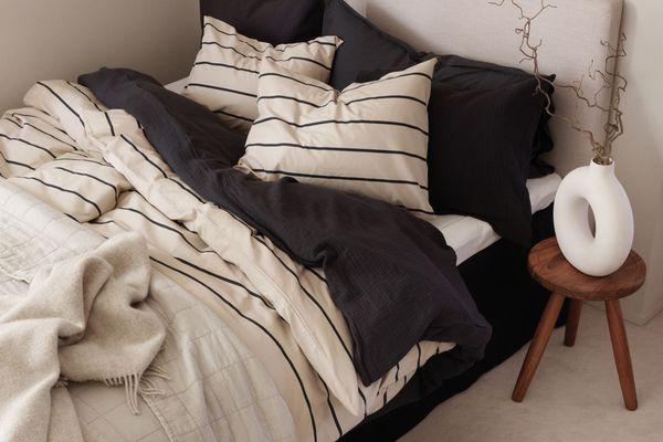 Ceramic Donut Vase next to bed.