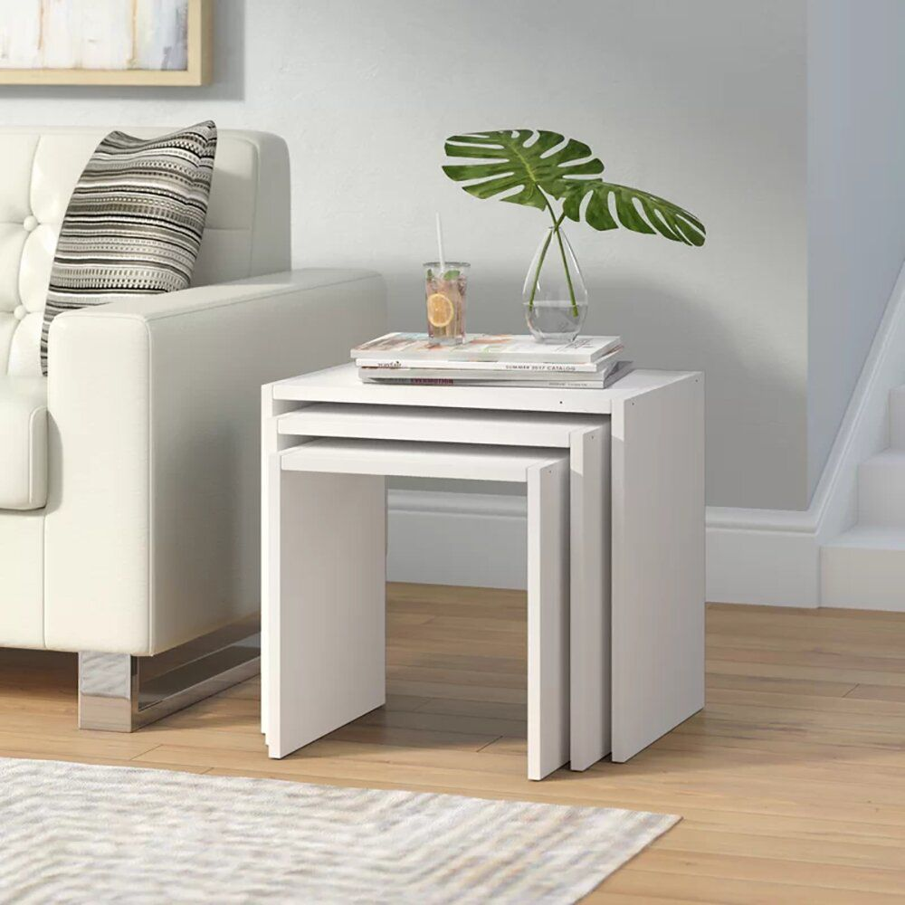 A set of white nesting tables, which is currently for sale at Wayfair