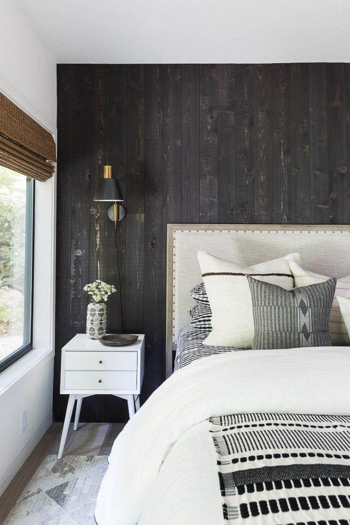 Dark wall in a farmhouse bedroom