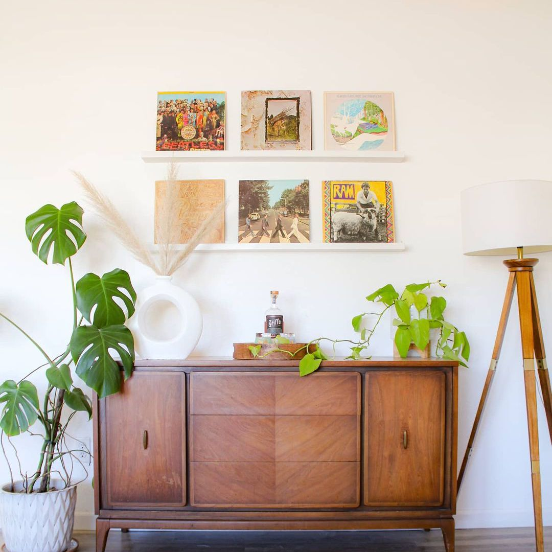 Console table with plants.
