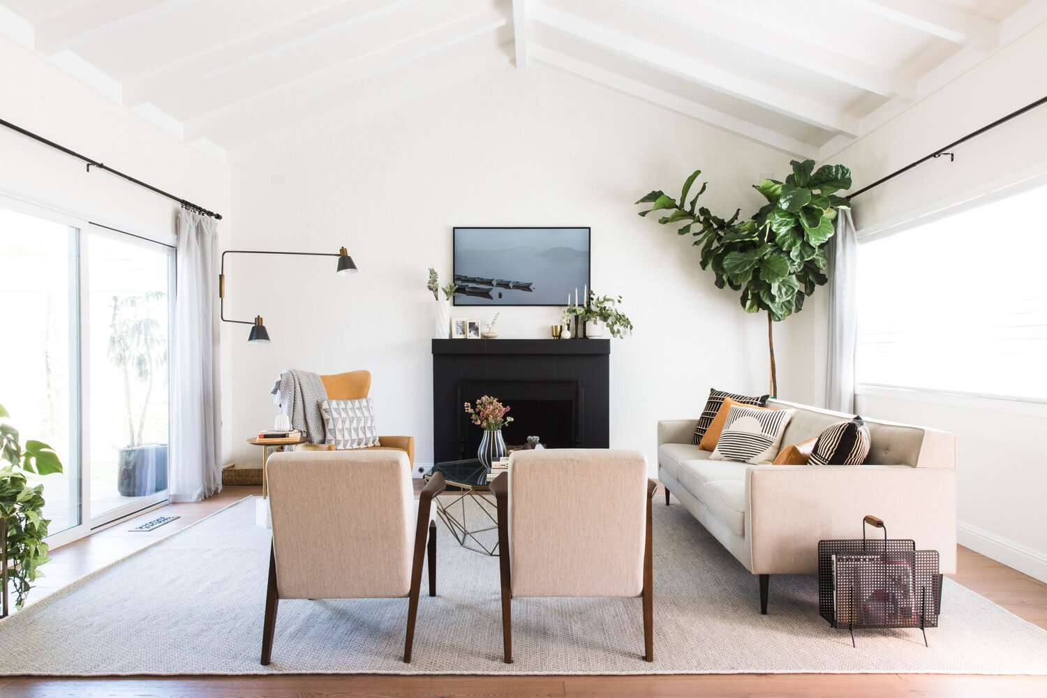 light and airy living room with a tall fiddle leaf fig in the corner