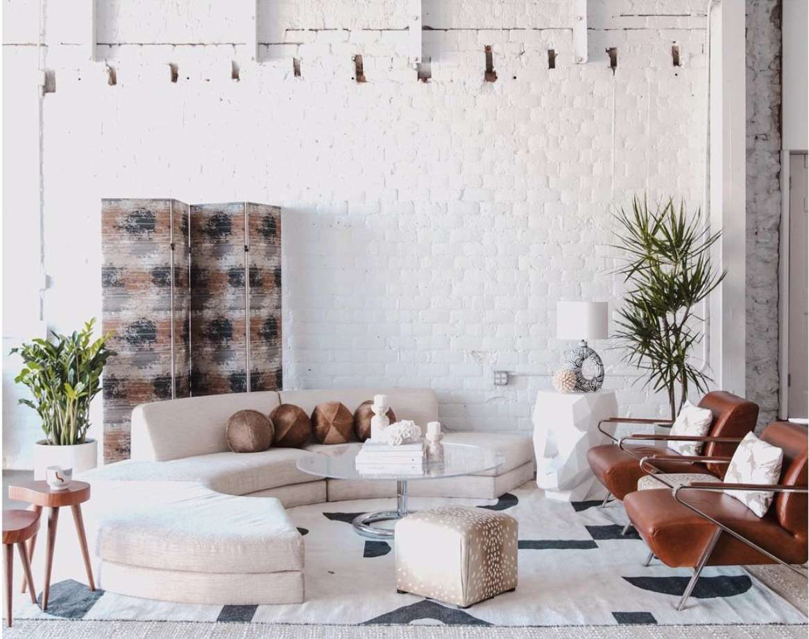 lounge living room with painted white brick wall