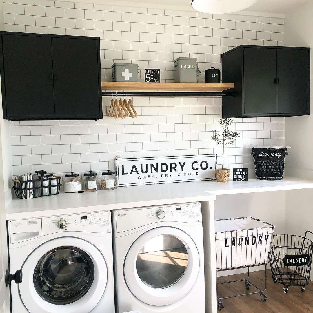 Laundry room with shelves and black cabinets