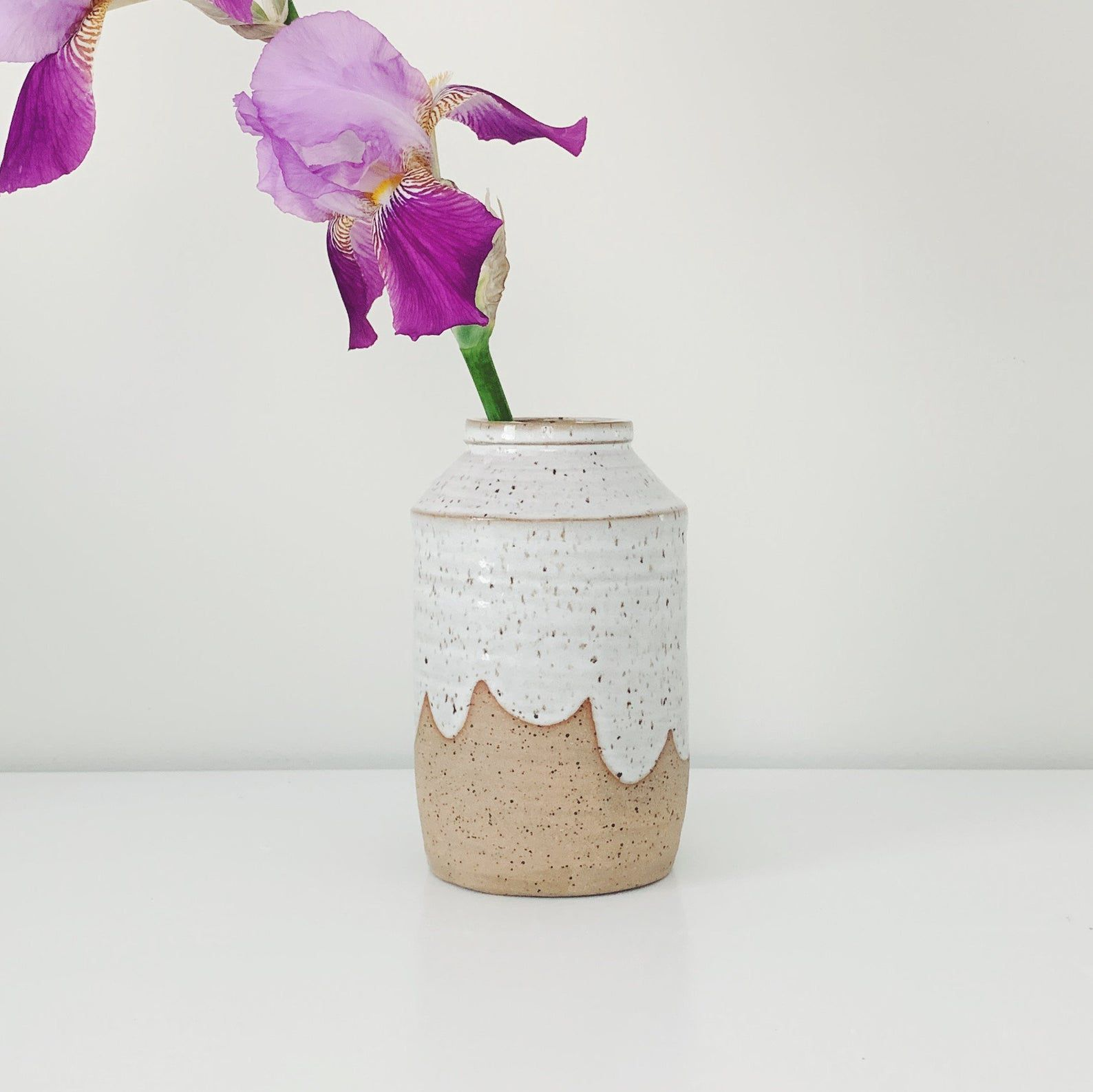 White Cloud Ceramic Vase sports a purple orchid
