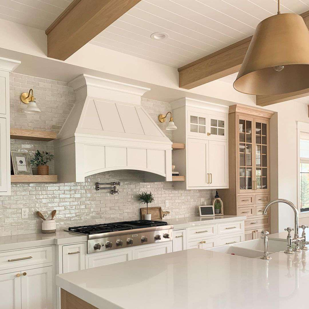 Kitchen with a large range hood