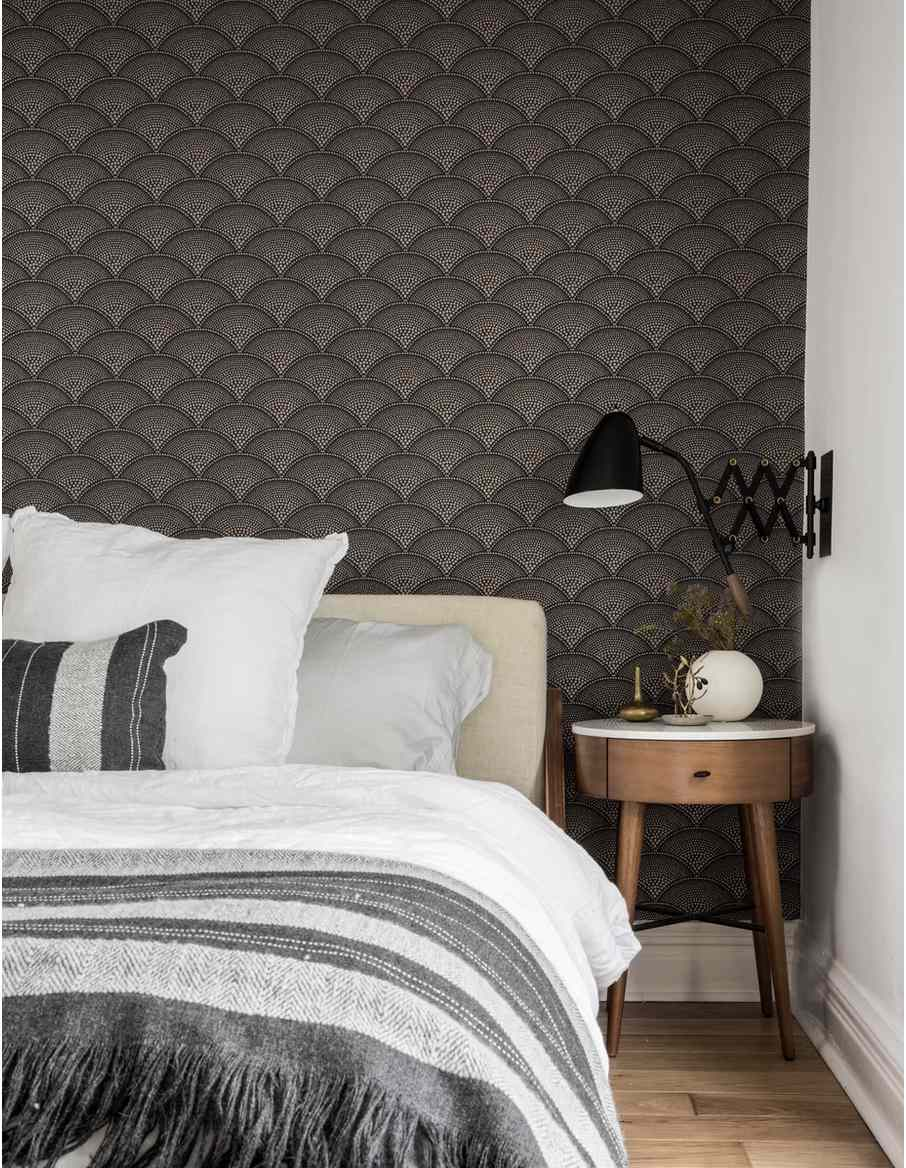 bedroom with dark wallpaper on back wall