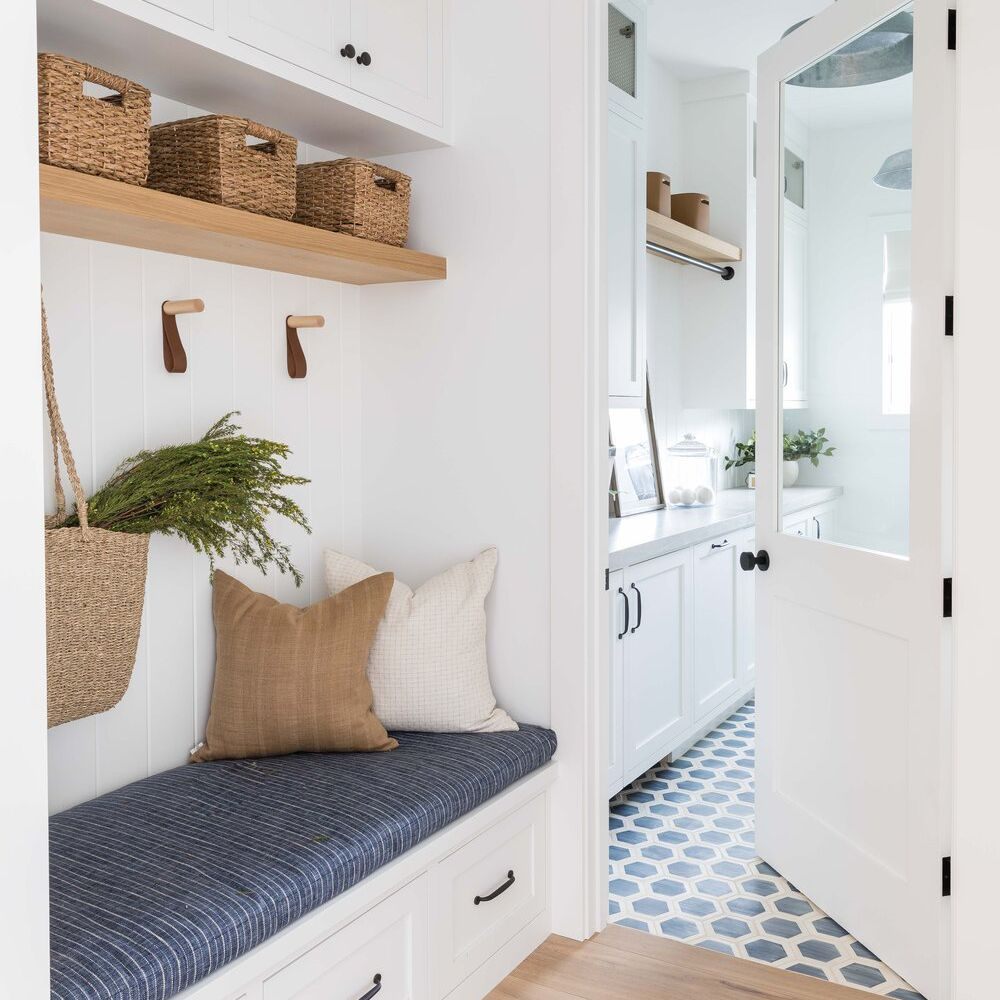 Chic mudroom with bench and storage baskets.