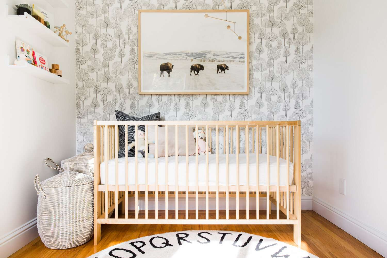 nursery with wooden crib, buffalo artwork