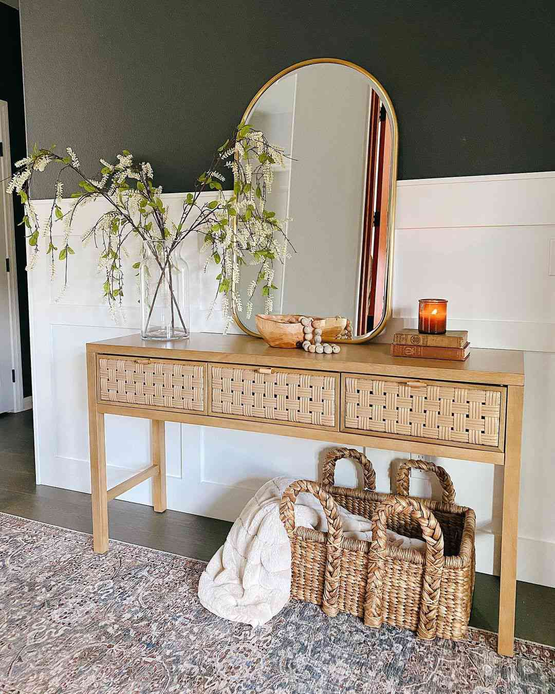 Boho rustic entryway table with mirror and plant.