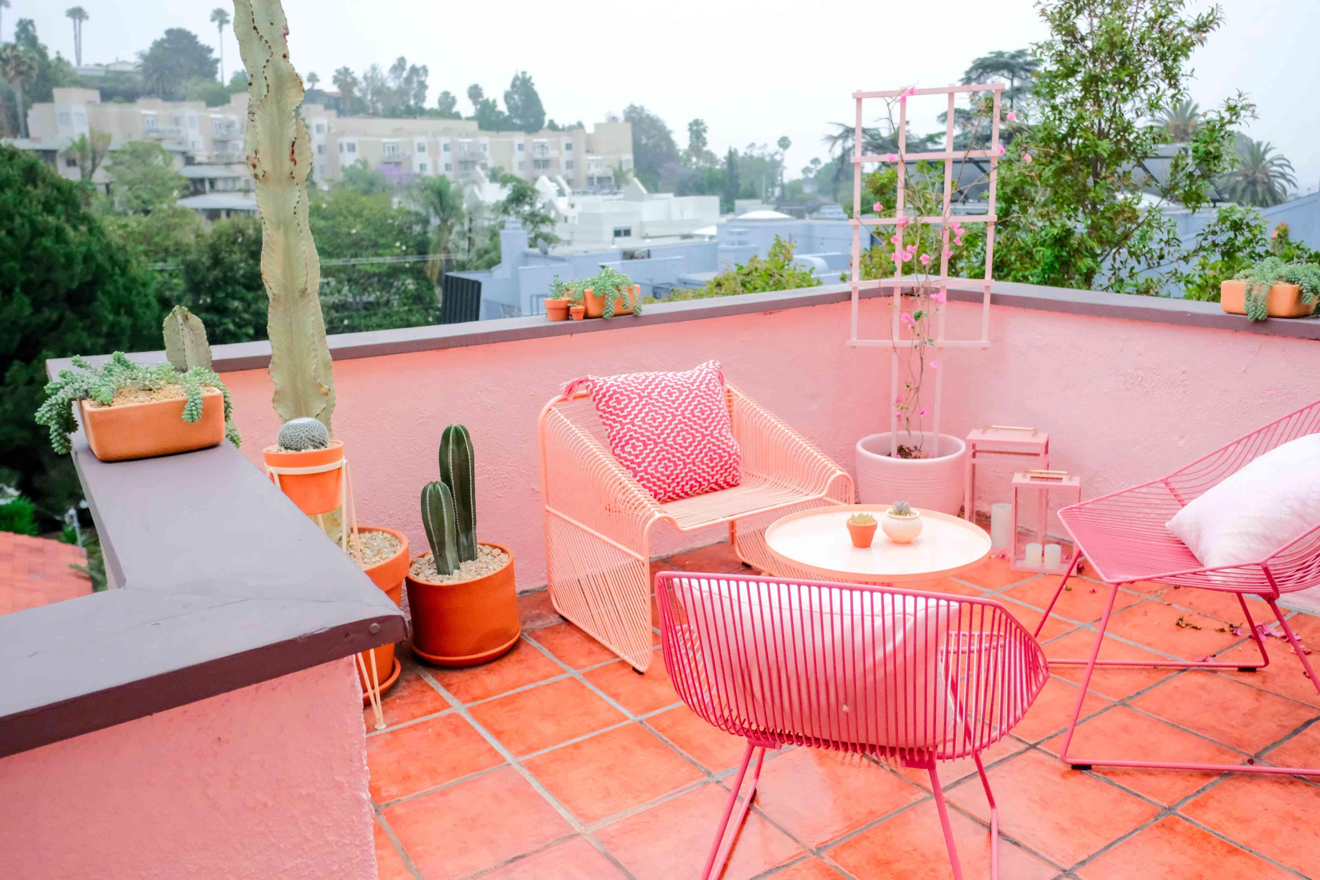 pink balcony overlooking california skyline