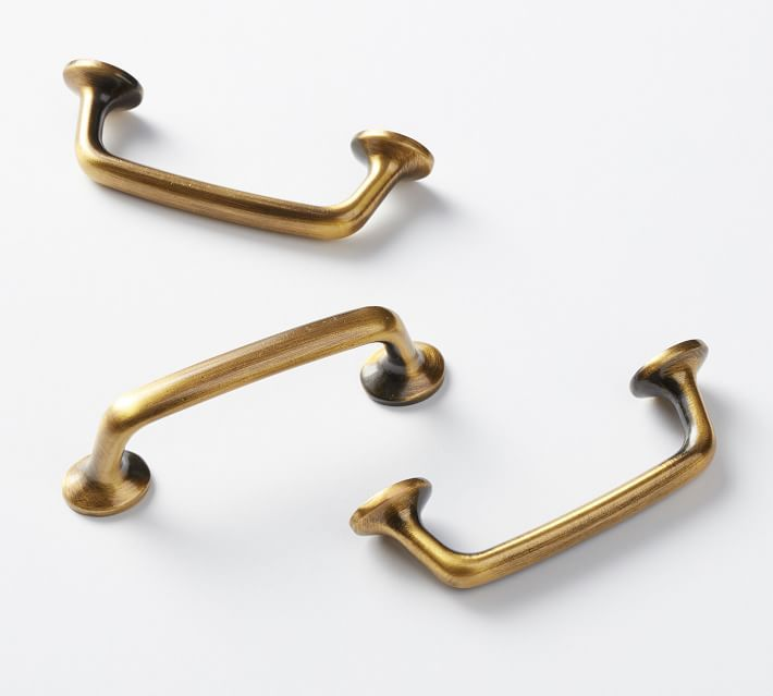 Three slightly distressed brass drawer pulls