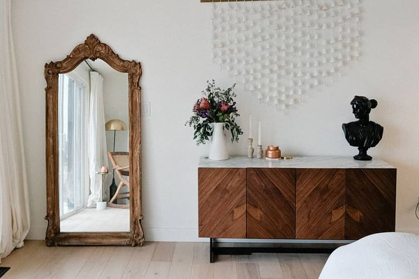 white bedroom with full length mirror
