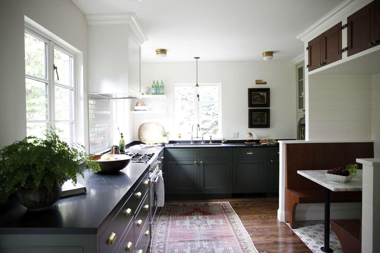 faded kitchen rug in dark green kitchen