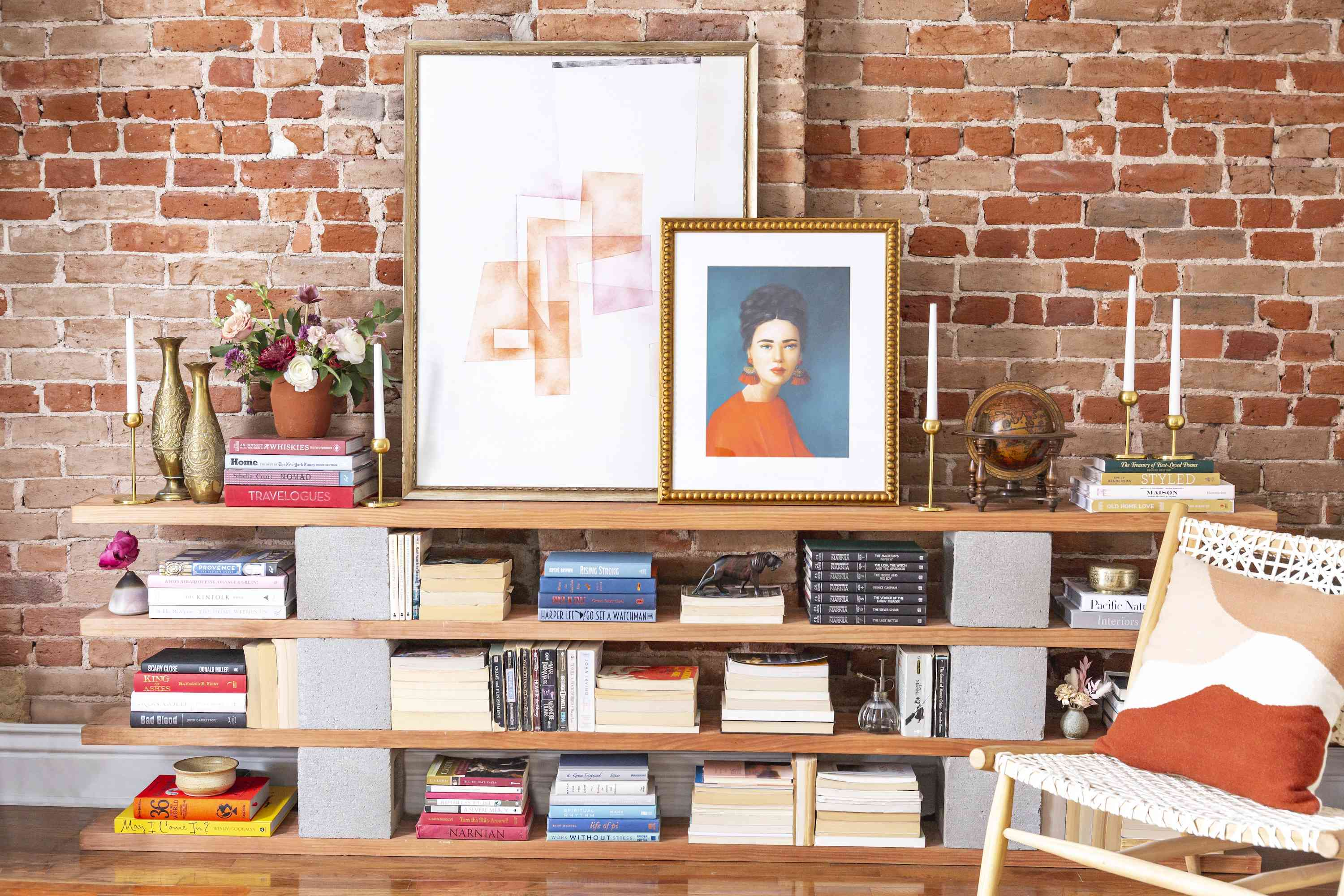 Open shelving with lots of books and art.