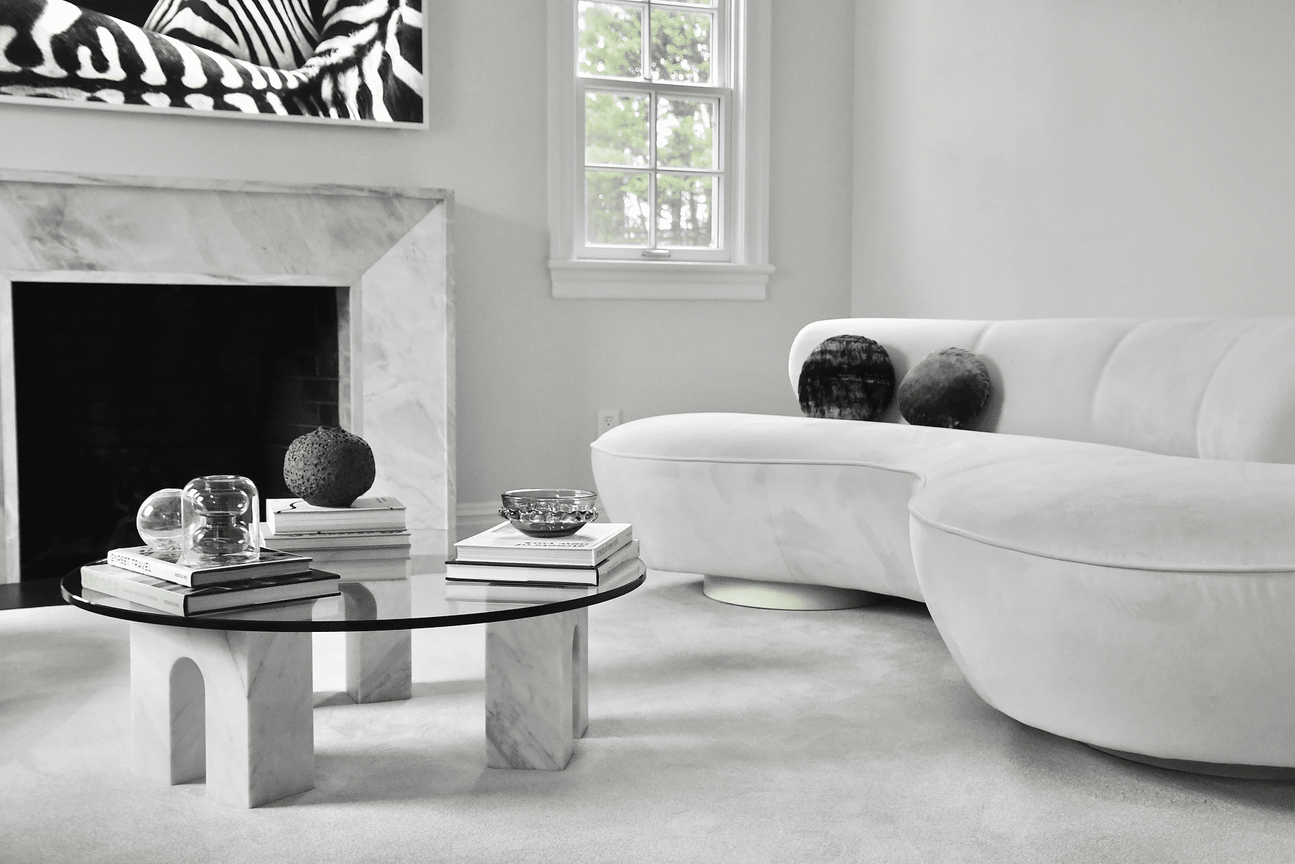 A living room filled with light gray modern furniture