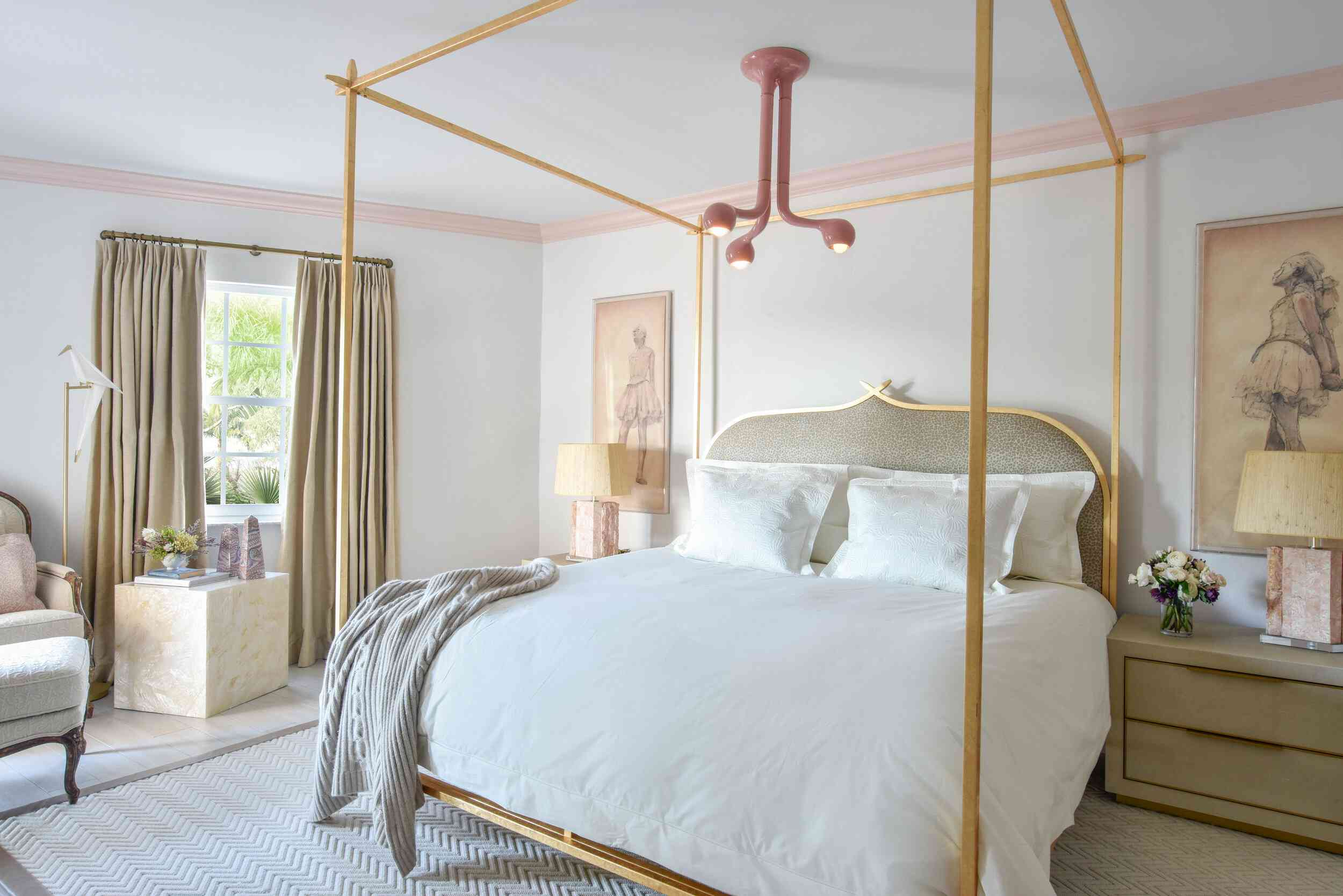 Romantic bedroom with gold and pink accents.