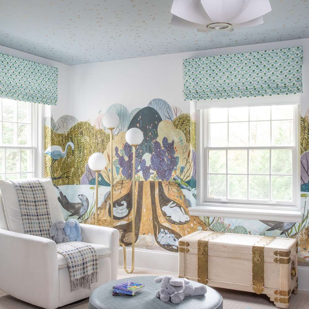 Nursery with woodland creature wall mural