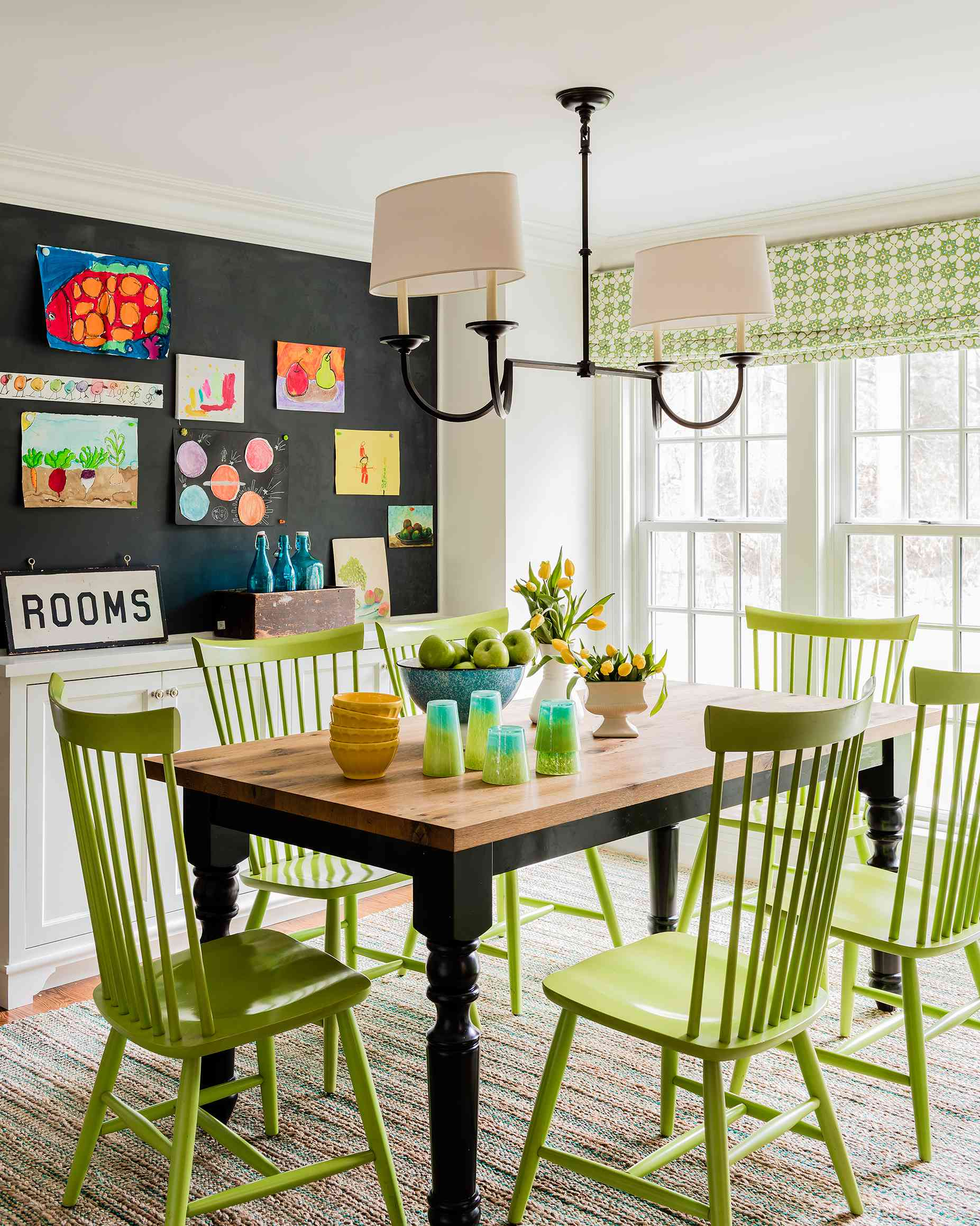 Dining nook with lime green chairs.