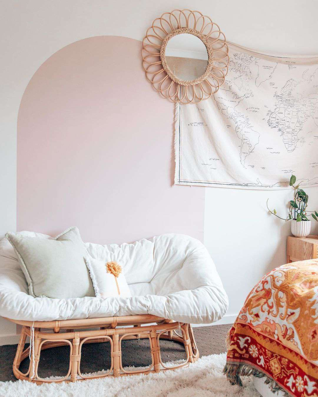 Pink painted arch on wall.