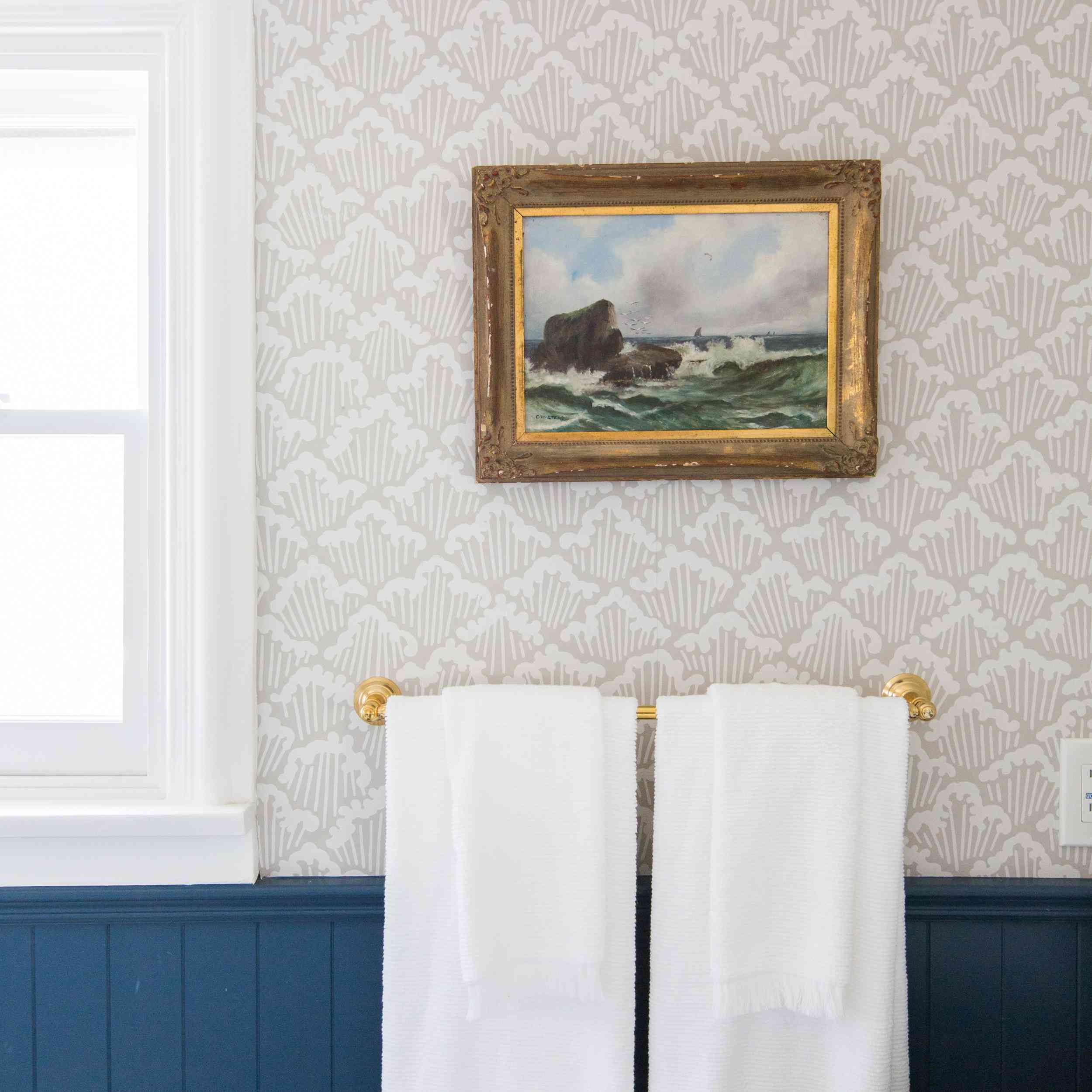 Bathroom with wallpaper and wainscoting