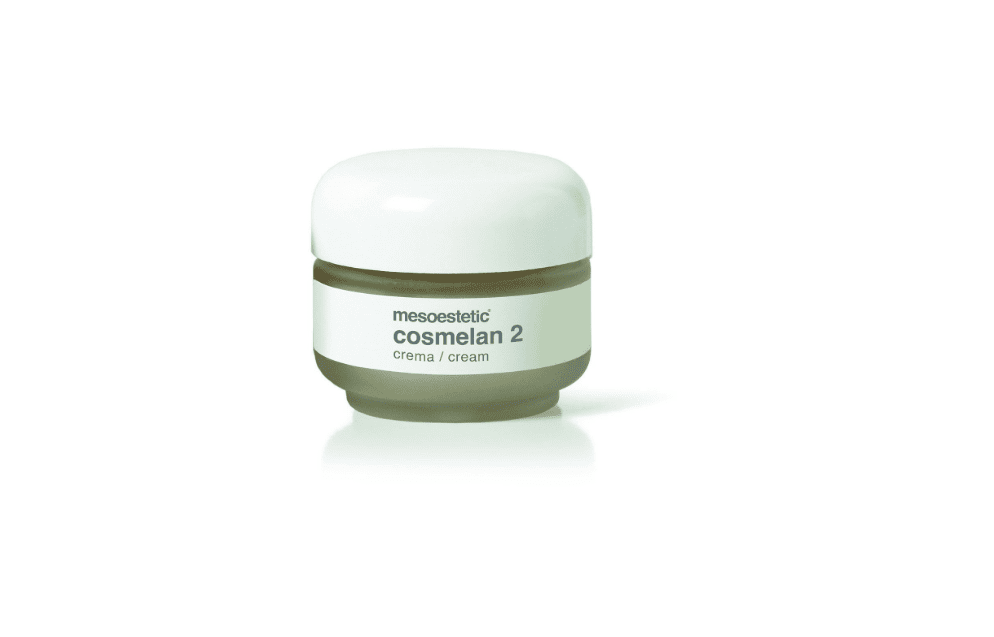 A glass container full of skin serum with a white label and lid.