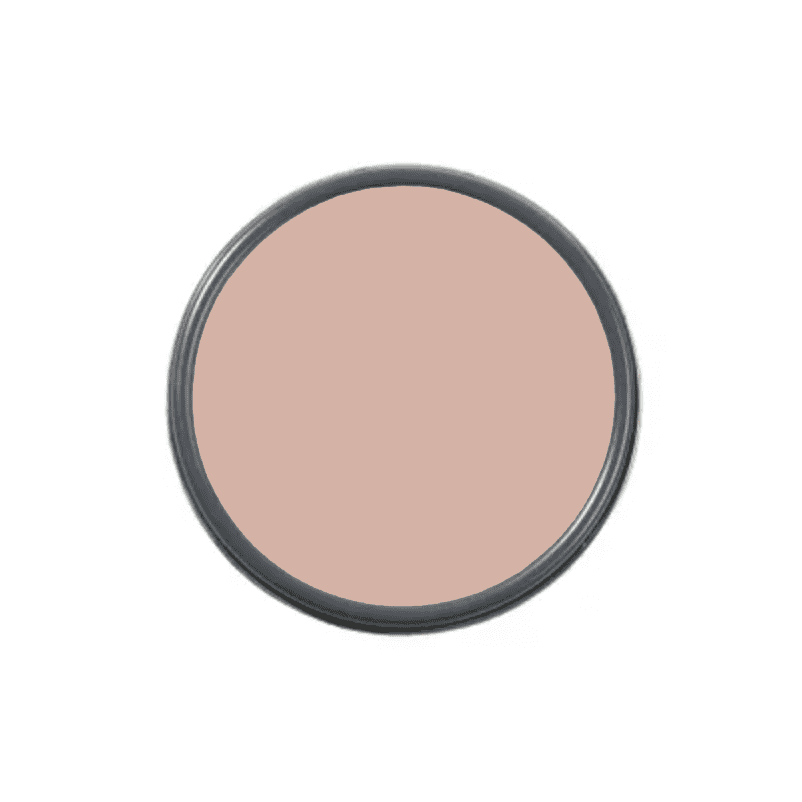 An overhead shot of a paint can with blush paint in it