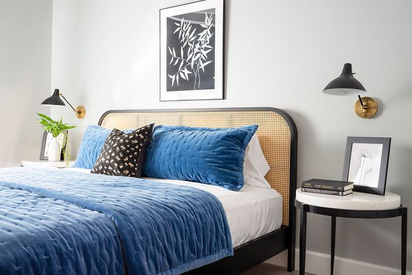 cane headboard and blue velvet bedding