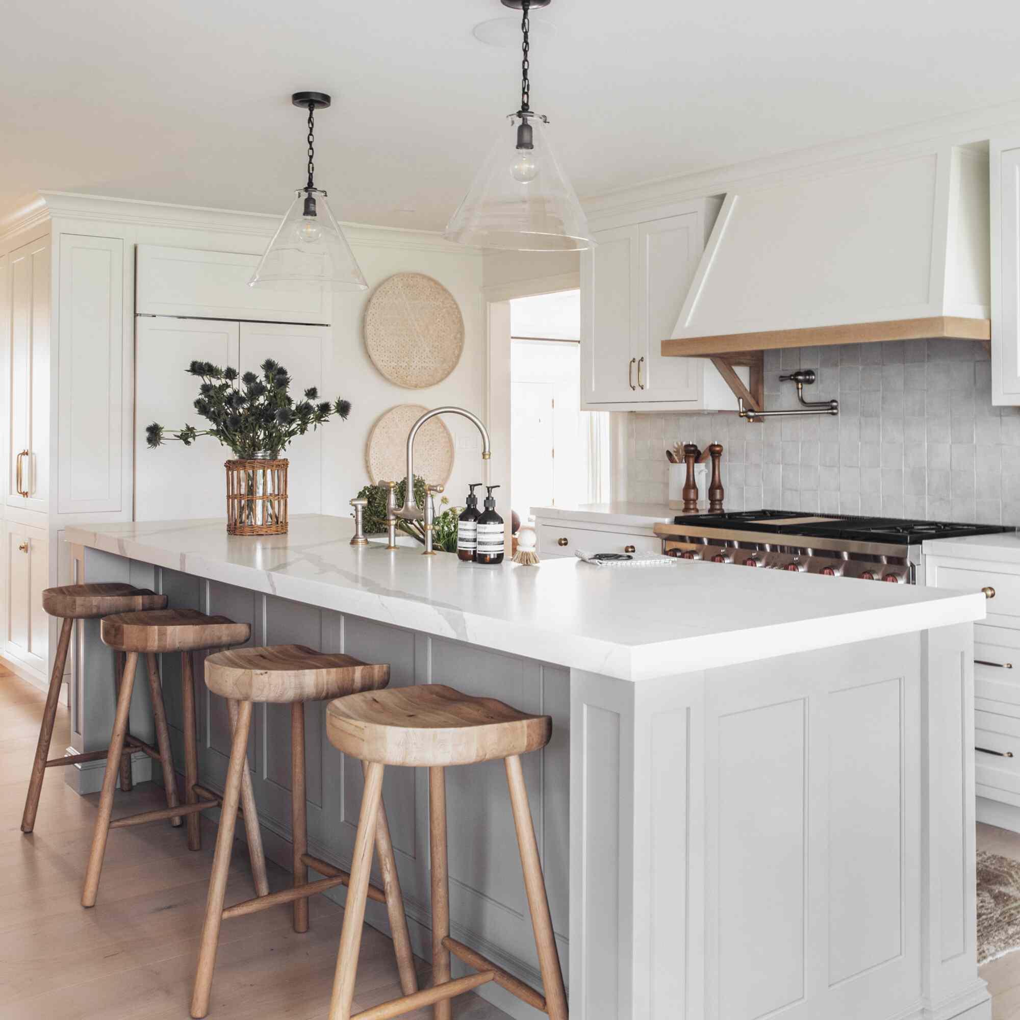 Minimalist kitchen with vases of greenery