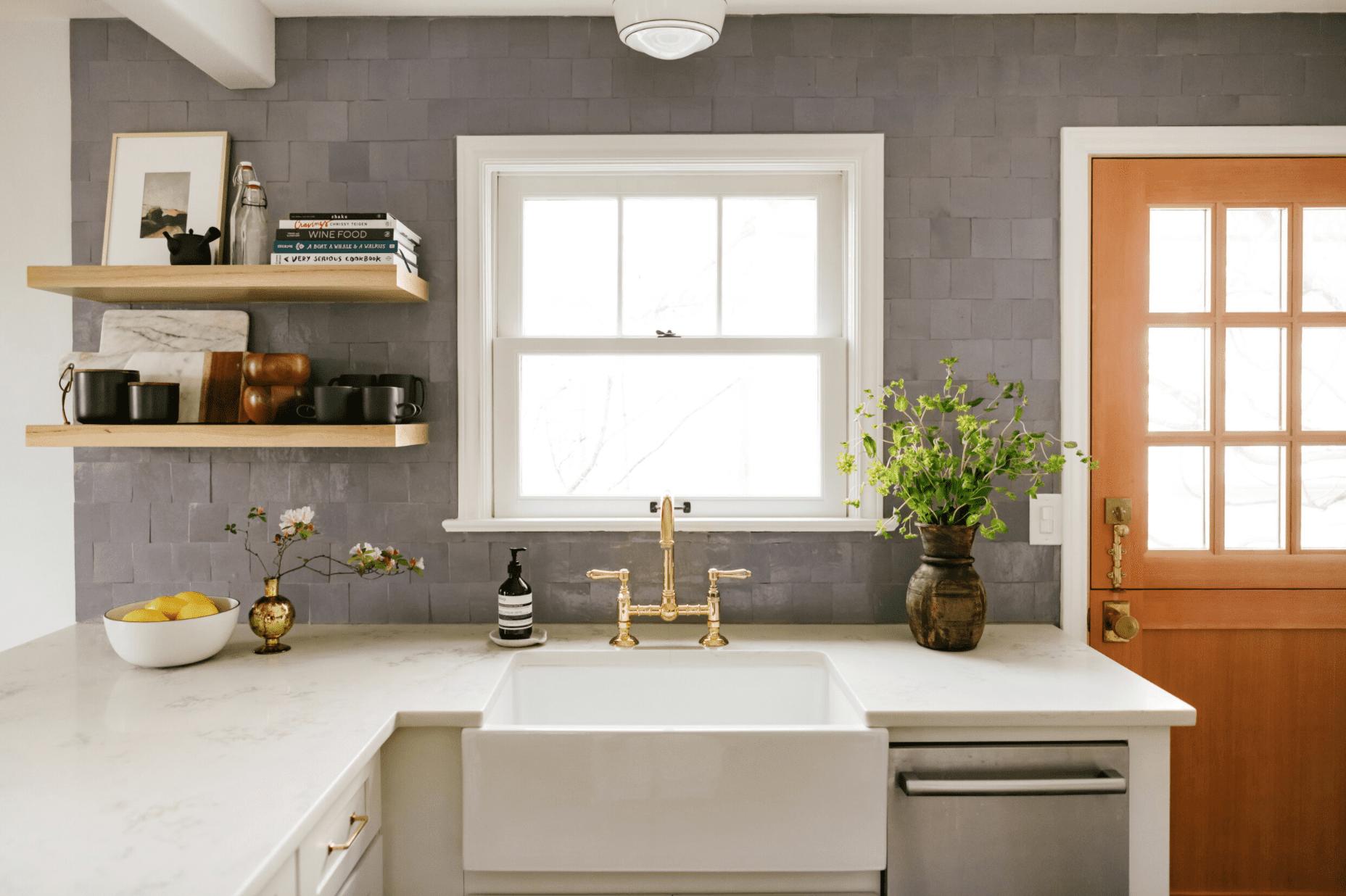 A kitchen backsplash lined with mauve tiles