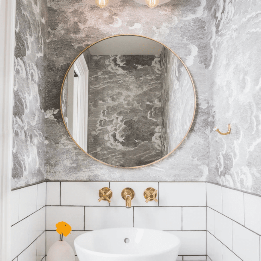 A powder room with black and white wallpaper in it